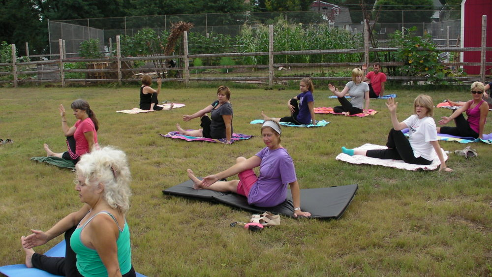 HOLD THAT POSE! Free yoga class at Morristown's Urban Farm at Lafayette. Photo by Kevin Coughlin