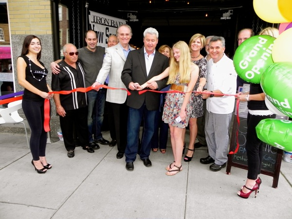 Morristown Mayor Tim Dougherty, center, cuts ribbon at June 2012 grand opening of the Iron Bar. The Mayor is calling for 'creative cooperation' to ease friction between residents and bar owners. Photo by Berit Ollestad