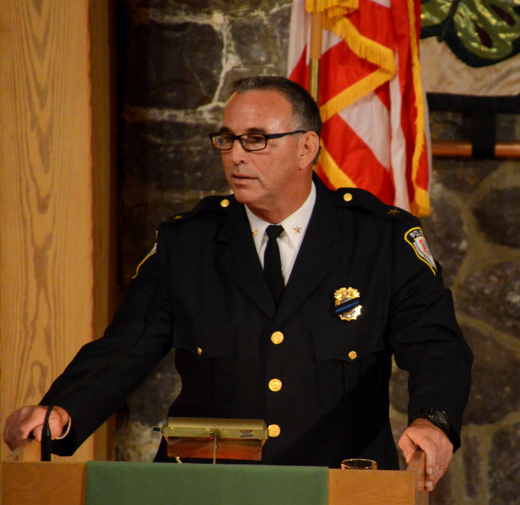 'STAND WITH ME' : Morristown Police Chief Pete Demnitz addresses interfaith vigil. Photo by Dave Sullivan