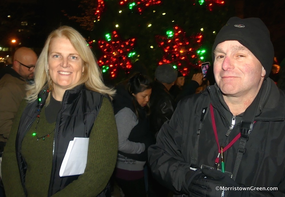 Karen Carvelli of the Morristown Partnership and Morristown Green sharpshooter Jeff Sovelove, at Santa's arrival on the Morristown Green, Nov. 25, 2018. Photo by Kevin Coughlin