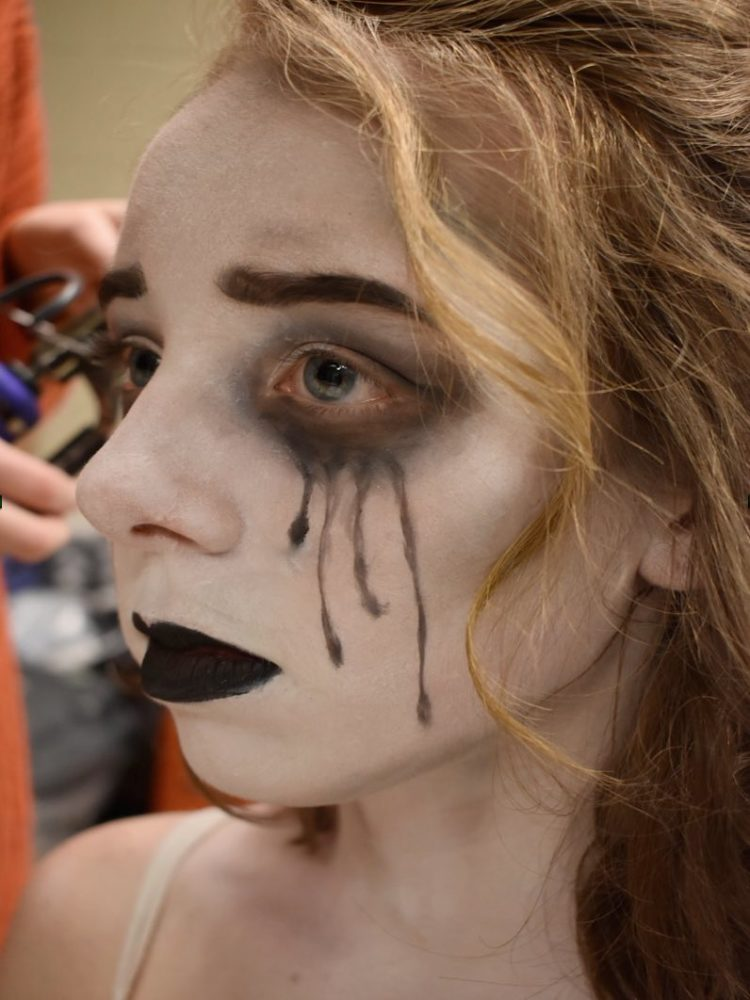 Sophomore Carly Nicolai gets made up as an Ancestor in 'The Addams Family,' March 2019. Photo by freshman Kristina LaMontagne .